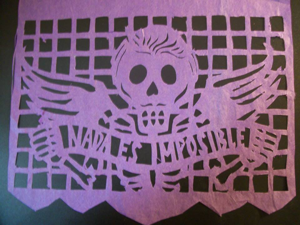 "traditional ""papel picado"" made by hand by Gustavus Spanish student Jenn Davis '15"